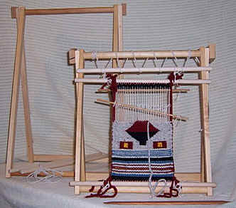 Spriggs Travel A-frame Navajo Looms. Designed by Carl Spriggs for table-top use, they collapse for easy travel with your project still on the loom.Click here for more information.